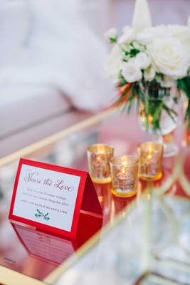winter holiday wedding reception mirror table red holiday sign share the love custom snapchat filter