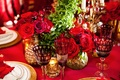 red and crystal glassware, roses in gold mercury vases, and votive candles.