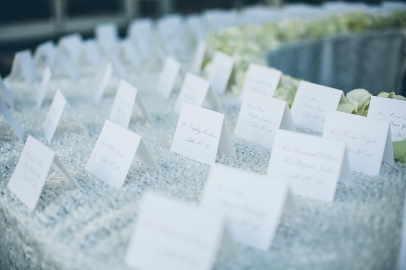Sequined linens topped with simple seating card