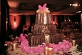 Brown frosted cake with gold and copper details
