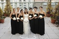 Bride with bridesmaids in strapless black dresses