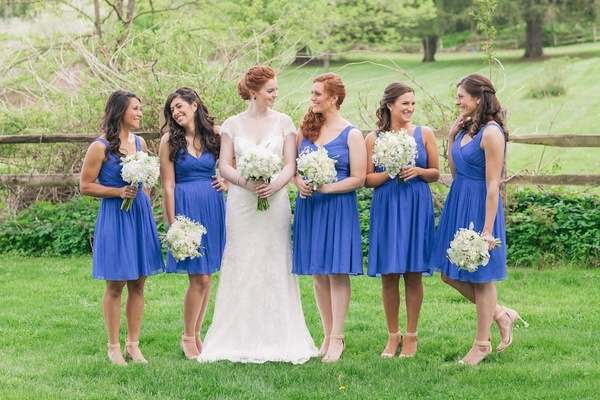 Bride with bridesmaids in short V-neck gowns