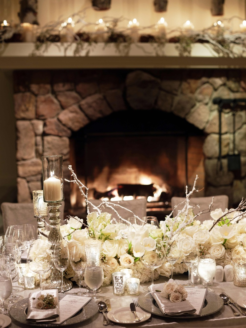 Stone fireplace and mantle decorated with flowers