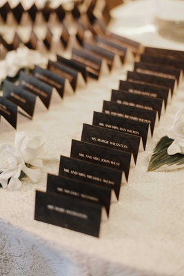 wedding reception white linen white gardenia flower black tented escort card tropical print block
