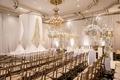 wedding ceremony ballroom the legacy castle white gold decor drapery flowers candelabra