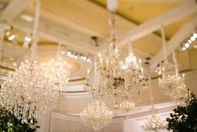 Beverly Hills wedding with many chandeliers in ballroom