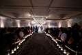Guests taking their seats at chrome silver velvet chairs bride and groom jewish ceremony chuppah