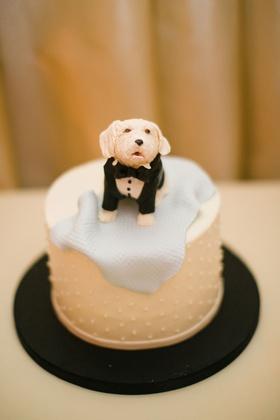 small groom's cake surprise swiss dot design topper designed to look like dog in tuxedo blue blanket
