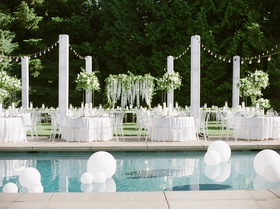 brandin cooks wedding, outdoor reception set up next to pool with large matte balloons