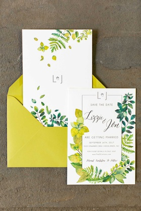 wedding invitation suite save the date yellow envelope and flowers greenery