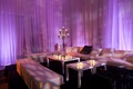Purple lighting at wedding reception lounge with candlestick decoration