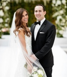 cute couple in chicago harold washington library wedding ceremony greenery white flowers bouquet