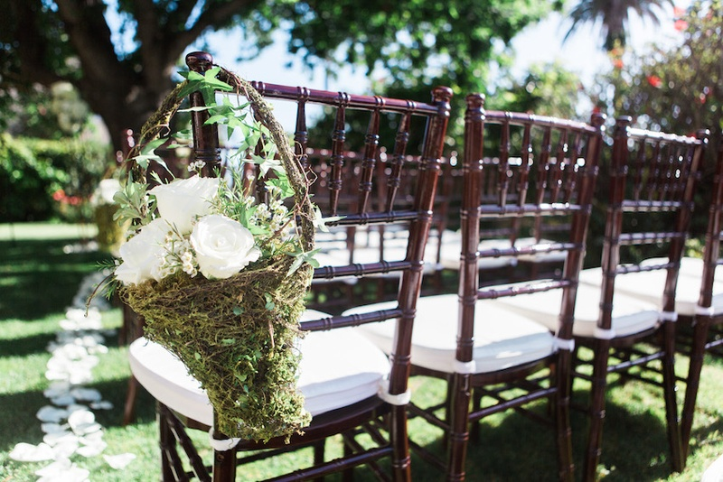 Garden Wedding Reception With Brown Chiavari Chairs And Grassy Baskets Filled White Roses