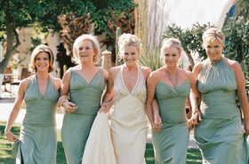 Bride with four blonde bridesmaids in light green dresses