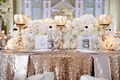Sweetheart table with Jones soda bottles and gold tablecloth