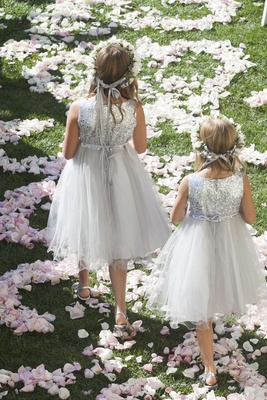 Flower girls in metallic sequin dresses with flower crowns
