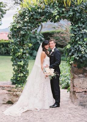 bride in liancarlo spanish lace wedding dress groom in suit bridal veil guatemala wedding destinatio