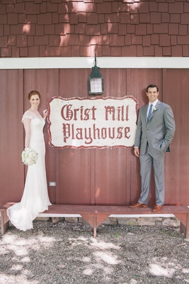 Couple next to Grist Mill Playhouse sign
