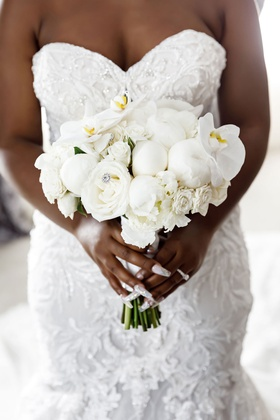 bride holding wedding bouquet white rose peony orchid with jewel accents manicure nails