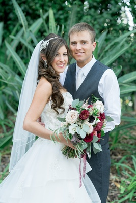 bride in alfred angelo gown, groom in dark navy grey suit with vest only