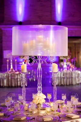 Wedding reception centerpiece with crystal candelabra, candles, and clear lampshade