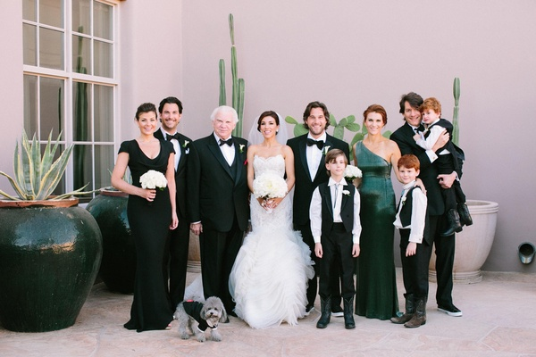 Adrianna Costa and groom with family members in black
