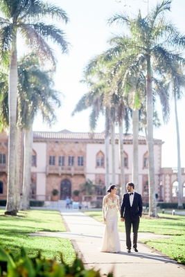 ca' d'van ringling mansion wedding with palm tree lined pathway