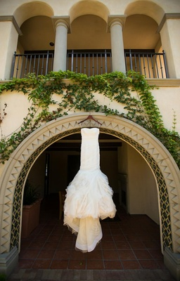 Vera Wang wedding dress hanging from Terranea balcony