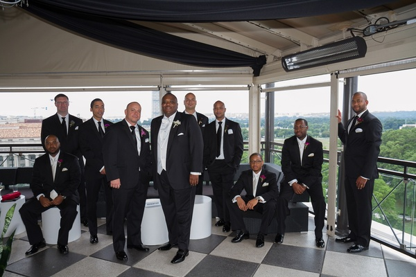 African American man with friends in tuxedos