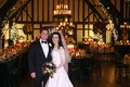 Bride in Oscar de la Renta wedding dress with groom in reception room with holiday theme