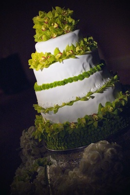 White wedding cake with green orchid decorations