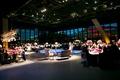 a dark reception space concept featuring lounge furniture tall windows blue dance floor night