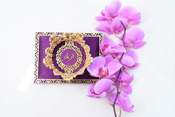 royal purple and gold wedding invitation suite, fuchsia orchids, golden crown