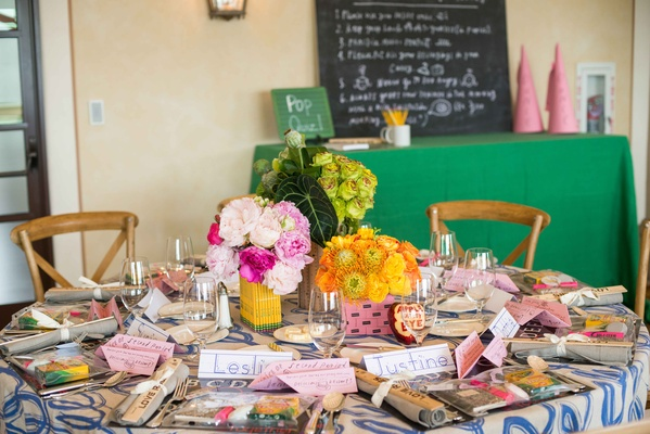 pink peonies in pencil centerpiece, yellow flowers in pink eraser centerpiece, green in ruler vase