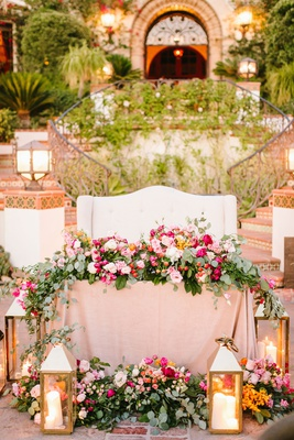 wedding reception spanish style venue ranch white settee sweetheart table greenery pink flowers