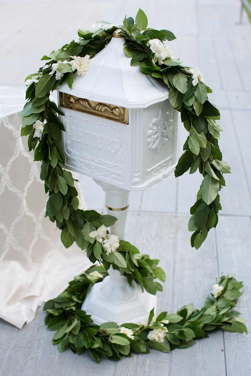 Wedding gift box area garland of greenery ivory flowers white letter box gold details hardware