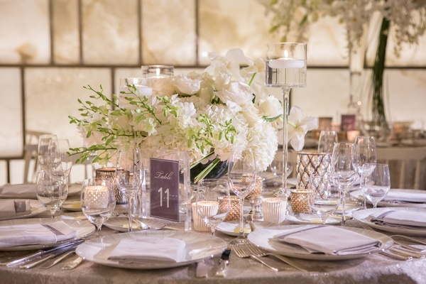 low white floral arrangement greenery accents table number silver new york wedding reception