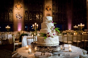 four tier wedding cake with classic design, fresh flowers and ferns