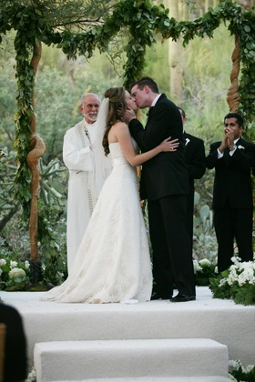 Bride and groom kissing as husband and wife
