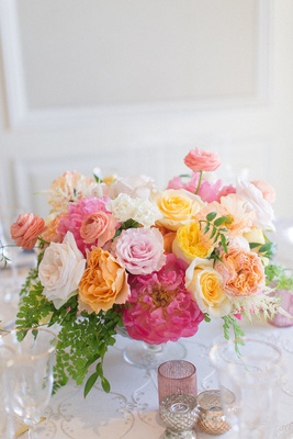 wedding reception centerpiece pink peony yellow rose orange garden rose ranunculus greenery