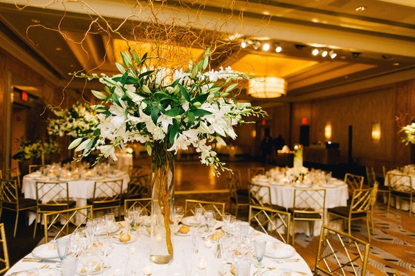 Wedding reception table with white stargazer lilies, orchids, curly willow, Ritz-Carlton Battery