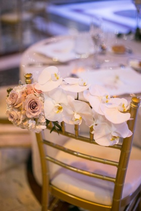reception chair floral adornment orchids roses decoration back of wedding feminine touch wedding