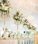 tented garden party wedding reception, gold and white candelabra with candles & floral centerpieces