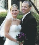 Bride in a strapless gown with ruched bust and lace skirt with groom in tuxedo