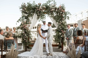 wedding ceremony bride groom boho chic design greenery pink lavender flowers heatherlily