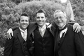 Black and white photo of groom with brother and father