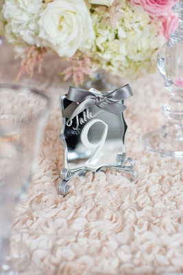 Mirror table number die cut white calligraphy and grey ribbon textured linens
