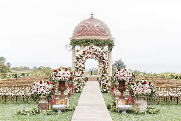 colorful ceremony space outdoors pelican hill resort newport beach wedding red pink flowers dome
