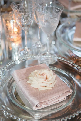 Mirror wedding table with antique glassware light pink napkin folded with pretty rose on top