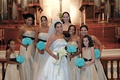 Bride with bridesmaids in front of church altar